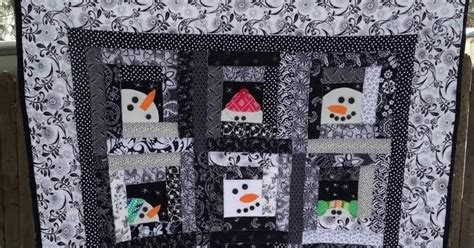 in the scrapatch snowman in the cabin window quilt along