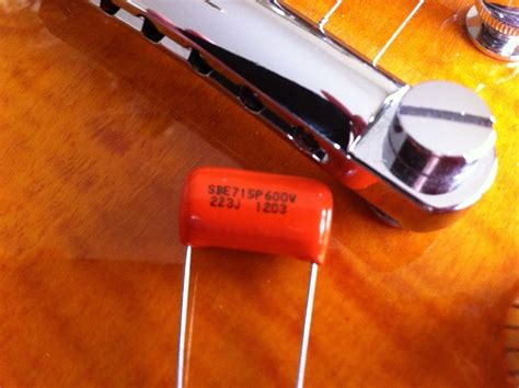 guitar capacitor differences stratocaster upgrade wiring kit bourns 250k pots sprague orange drop tone capacitor
