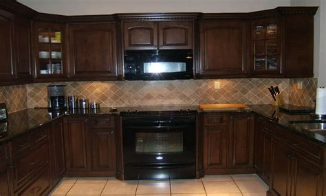 Dark Brown Kitchen Cabinets With Black Appliances Home Black And Brown Kitchen Cabinets