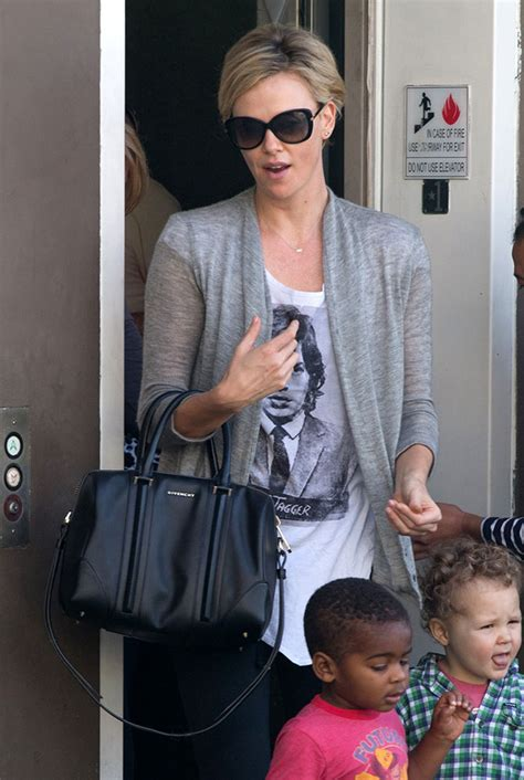 Charlize Theron With And Balenciaga Purses by The Many Bags Of Charlize Theron Page 9 Of 25 Purseblog