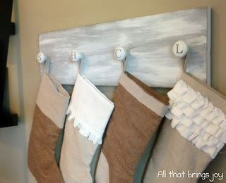 hang stockings without mantle idea for hanging stalkings without a mantel how the knobs are the initials of each