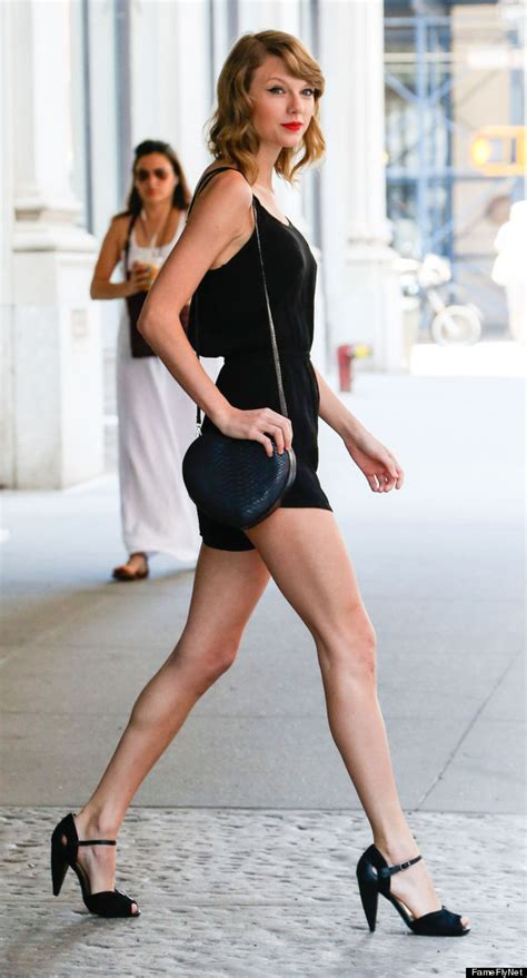taylor swifts legs look amazing in short shorts photos taylor swift is chic in all black with her famous red lips