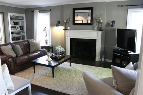 paint colors for living room with brown trim gray walls white trim brown leather sofa black accents
