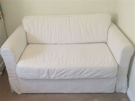 Two Seater Sofa Bed Ikea by Ikea White Two Seater Sofa Bed In Esher Surrey Gumtree
