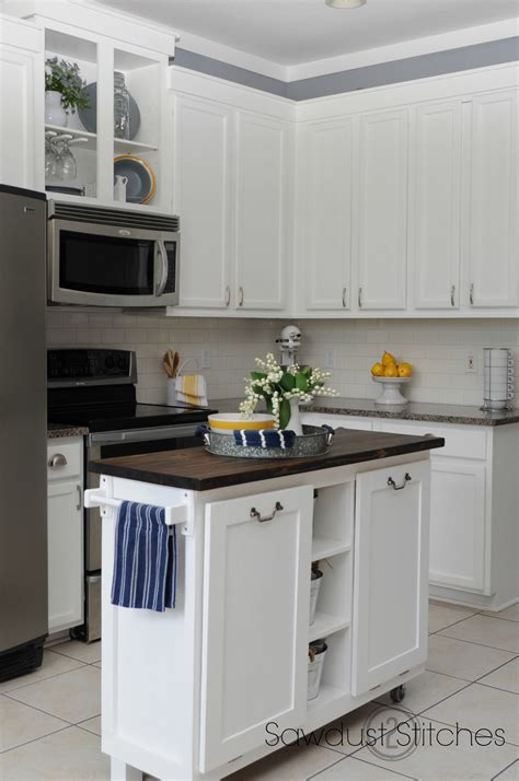 white painted kitchen cabinets remodelaholic diy refinished and painted cabinet reviews