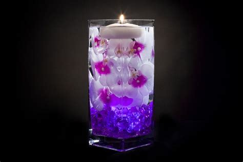 violet floral centerpiece with led lights and floating candles