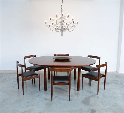 round extendable rosewood dining table by alfred hendrickx round extendable rosewood dining table by alfred hendrickx