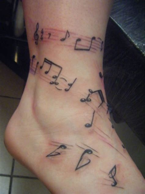 music notes with roses tattoo ink