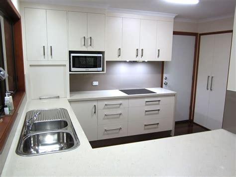 kitchen renovation brisbane with caesarstone benchtops and white macubus quarzite cashmere kitchen renovation with innovative design details