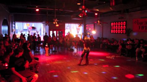 rumba room dancers with staff rumba room