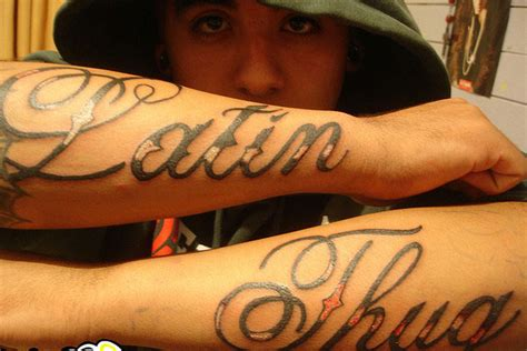 latin tattoo on arm thug tattoos tattoo design and ideas