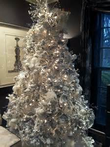 White Flocked Tree Decorations by Fresh Flocked Tree Decorated In White Sliver