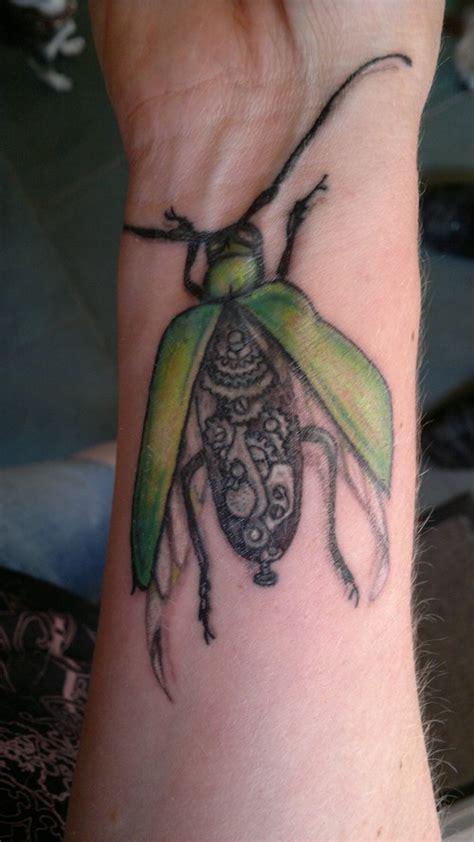 biomechanical wrist tattoo green biomechanical bug on wrist tattooimages biz