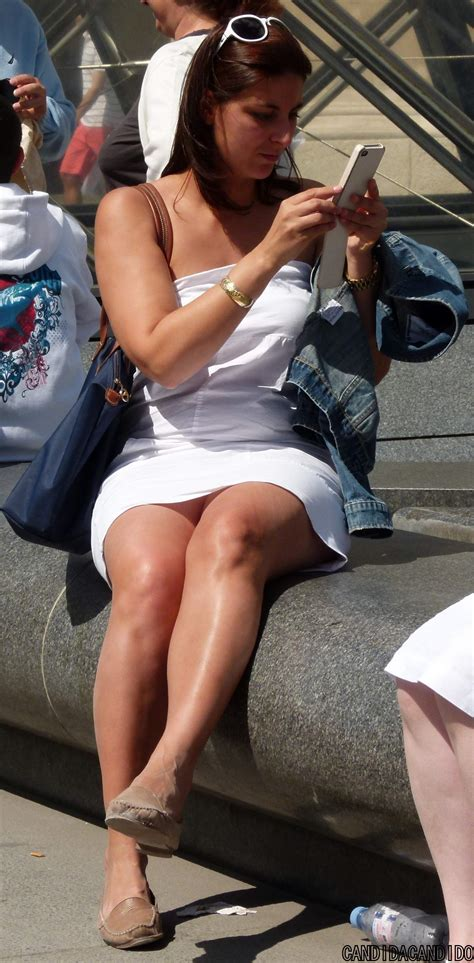 the candid candid with white dress crossing legs