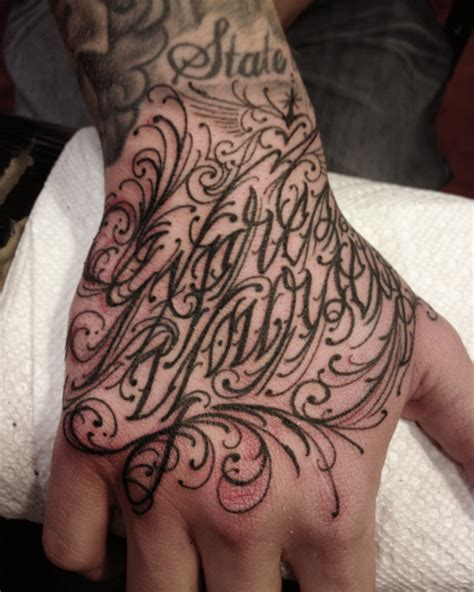 Tattoo Lettering On Hands | lettering hand tattoo by three kings tattoo