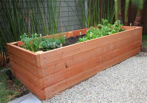 How To Make A Raised Planter by Building A Redwood Planter Raised Bed 8x3 Crafty
