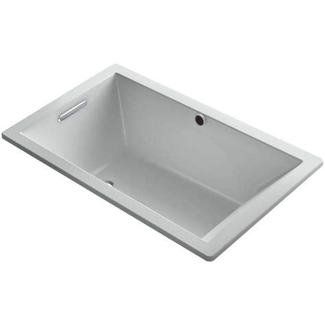 kohler underscore bathtub kohler underscore 5 ft reversible drain soaking tub in