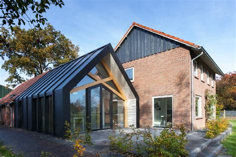 contemporary add on transforms this dutch 50s farmhouse