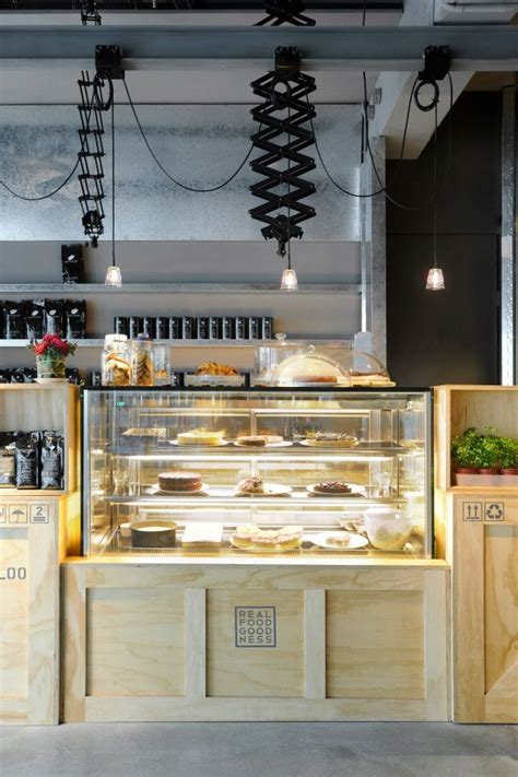 coffee shop wooden interior design love this pastry case awesome real food goodness logo