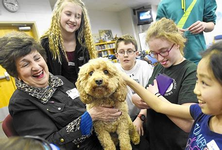 middle school students read  therapy dogs pets  wheels