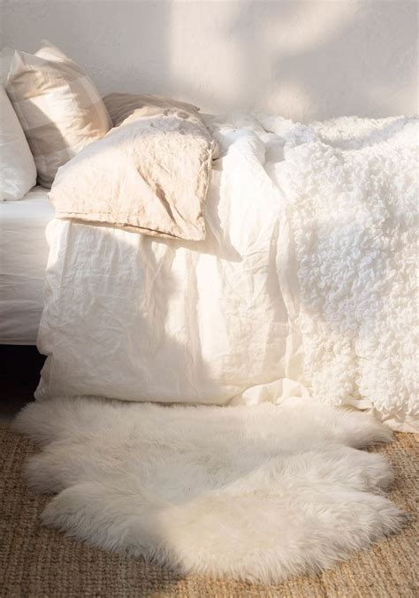 white fluffy bedroom rugs how to rock a faux fur rug in your home interiors