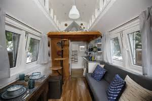 interiors of small homes inside a handsome tiny house with solar shingles curbed