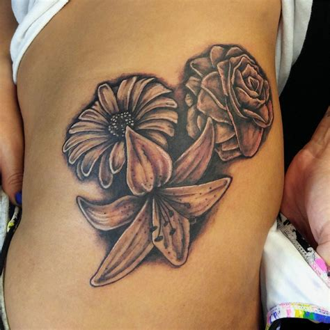 rose and lily tattoo by mike hessinger at moonlight