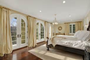 Furniture Row Bedroom Sets traditional master bedroom with french doors by houlihan
