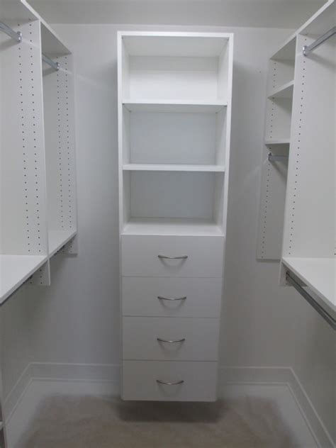 small walk in closet w shelves drawers and