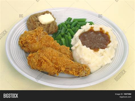 dinner potatoes fried chicken and mashed potatoes dinner stock photo