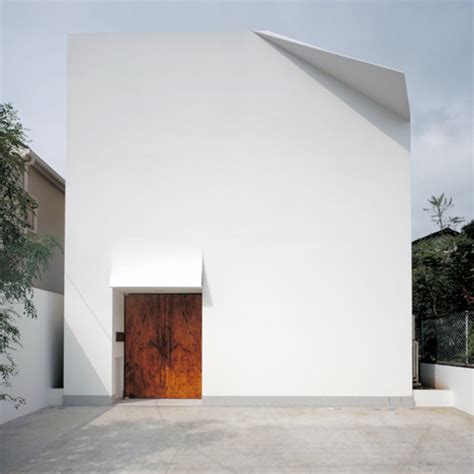 Folded Paper House - folded facade provides a paper like excess weight to yukio