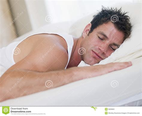 lying or laying in bed man lying in bed stock image image of peaceful laying