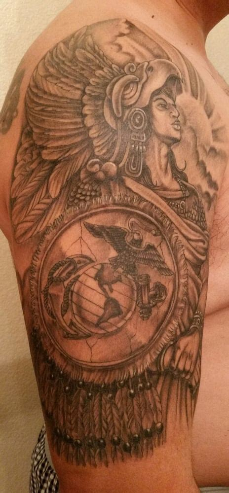 aztec warrior with marine corps emblem on his shield by