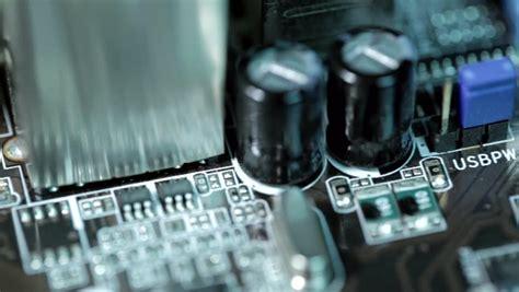 capacitors resistors diodes transistors up macro on circuit board with radio components motherboard transistors ic capacitors