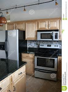 Top Kitchen Faucet Kitchen Wood Cabinets Stainless Refrigerator Stock Image