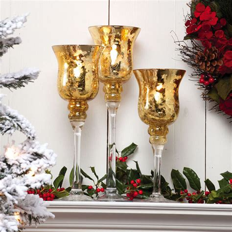 a christmas collection of 14 beautiful candle holders