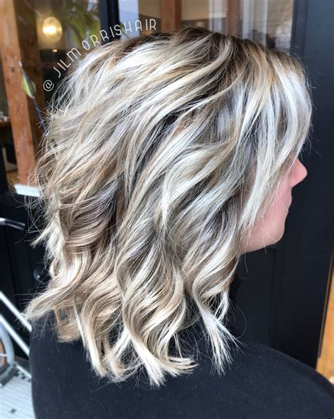 pictures of highlights for gray roots icy white balayage blonde highlights with an ashy shadow