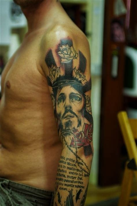 jesus tattoo in the bible jesus with red roses and text of bible tattoo on shoulder