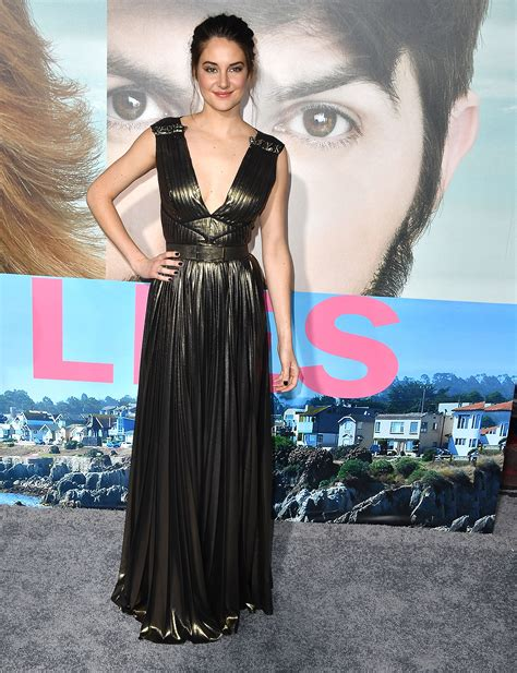 mesmerized   plunging black gold dress