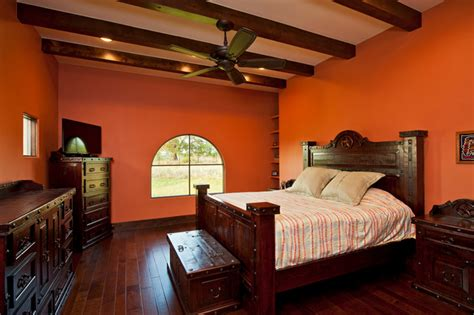 orange master bedroom master bedroom orange colored walls exposed beams hardwood floors