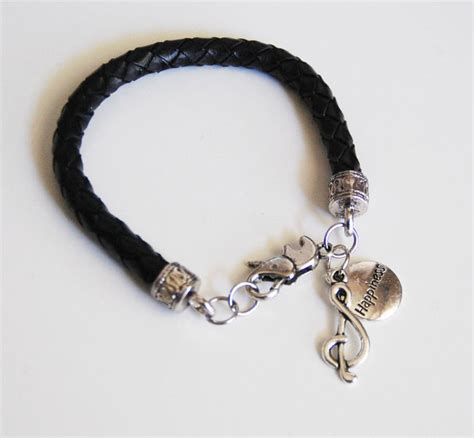 Gelang Dominica Leather Bracelets black braided leather bracelet with charm s leather bracel ferozasjewelery pinklion