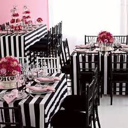 This round table covered with a black table cloth is accented with a
