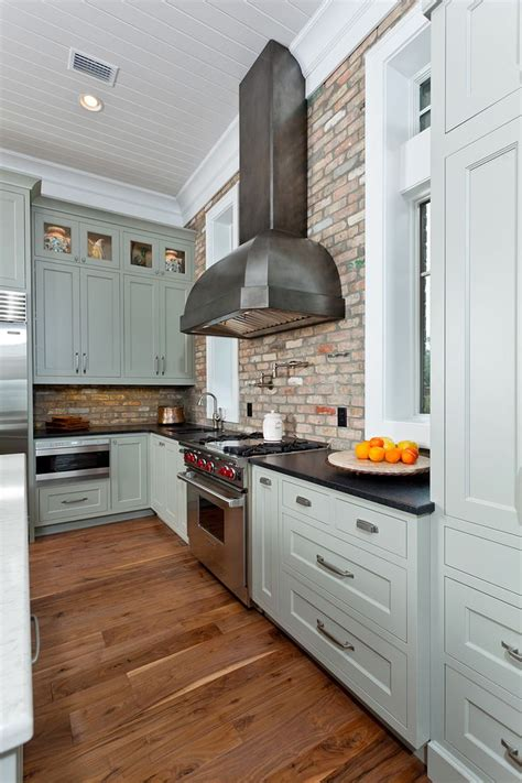 kitchen with brick backsplash gray shaker kitchen cabinets the cabinets are painted