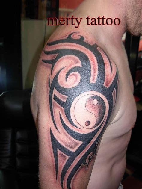 tattoo man yin yang and tribal on right half sleeve