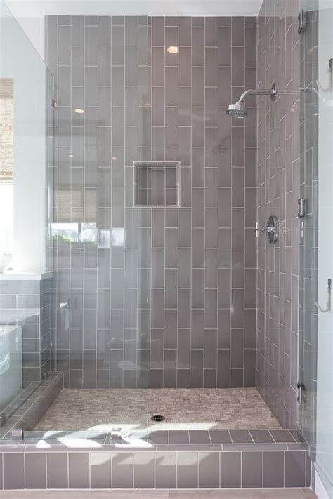 going vertical with subway tile 33 chic subway tiles ideas for bathrooms digsdigs