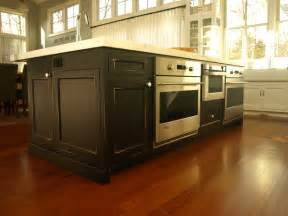 large working center island with double wall ovens and drawer microwave traditional kitchen