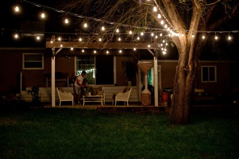 String Lights Outdoor Patio Backyard String Lights And Flowers Country Home Design Ideas