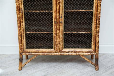 chinese bamboo kitchen cabinet for sale at 1stdibs antique bamboo cabinet with chicken wire doors for sale at
