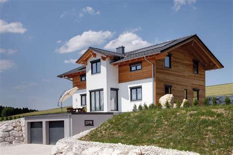 Holzhaus Am Hang by Tradition In Modern Massivholzhaus Sonnleitner