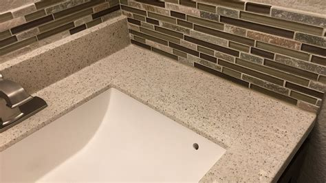 how to install a glass tile backsplash in the kitchen installing a glass mosaic tile backsplash in the bathroom